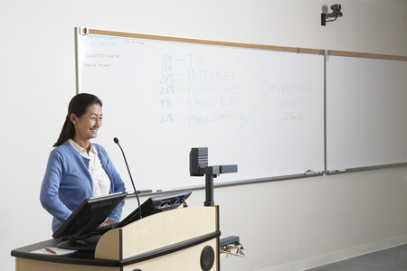 lecture theatre: Female teacher in lecture theatre LANG_EVOIMAGES