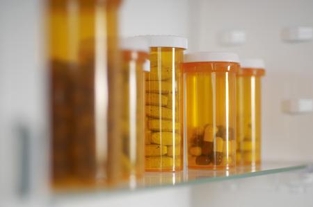 medicine cabinet: Bottles of pills in cabinet, close-up