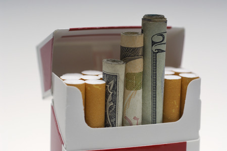 rolled up: Money rolled up in cigarette box, close-up