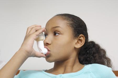 inhaler: Girl (7-9) using inhaler in hospital LANG_EVOIMAGES