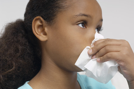 Girl (7-9) blowing nose, close-up Stock Photo - 3813025