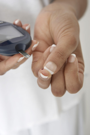 Woman taking diabetes test, close-up of hands Stock Photo - 3812752