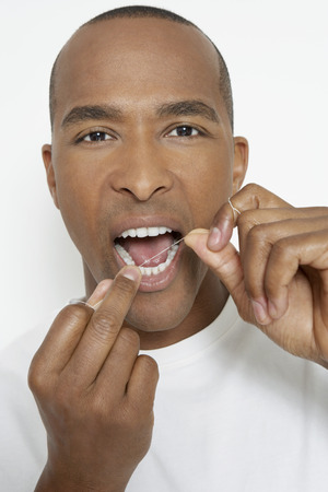 flossing: Man flossing teeth, portrait