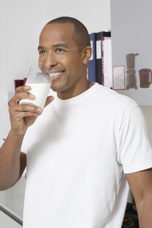 Man drinking milk in office Stock Photo - 3812792
