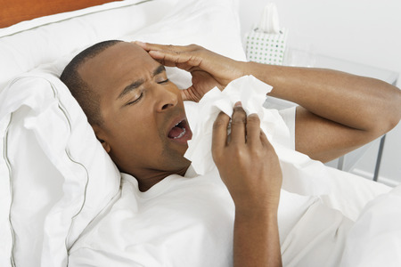 sick day: Man with flu in hospital bed