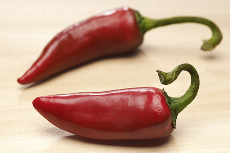 Two red chili peppers, close-up Stock Photo - 3812920