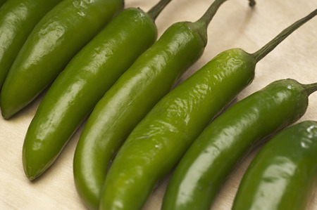 Green chili peppers in row, close-up Stock Photo - 3812992