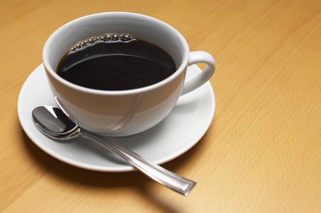 coffee spoon: Cup of coffee, close-up