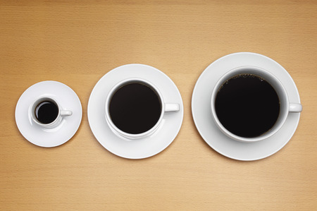 Three coffee cups of various sizes Stock Photo - 3813112