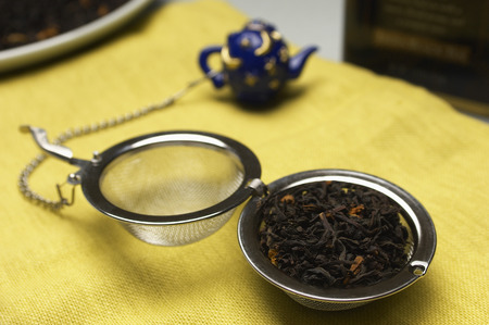 Tea strainer with leaves Stock Photo - 3813091