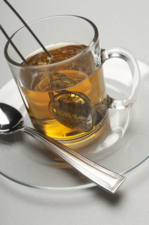 infusing: Glass with tea strainer inside, close-up LANG_EVOIMAGES