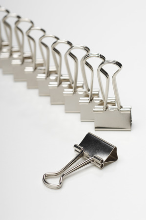 Row of binder clip on white background Stock Photo - 3812749