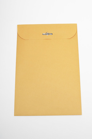 Brown envelope on white background Stock Photo - 3812776