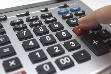 Person using calculator, close-up of finger Stock Photo - 3812942