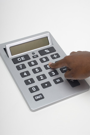 Person using calculator, close-up of finger Stock Photo - 3812808