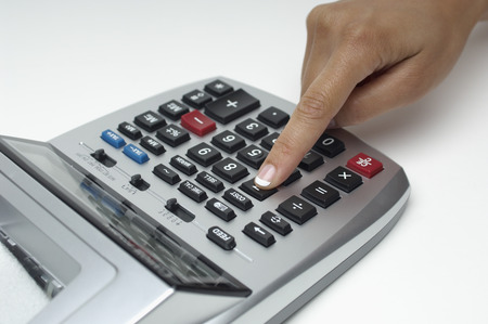 Woman using calculator, close-up of finger Stock Photo - 3812897