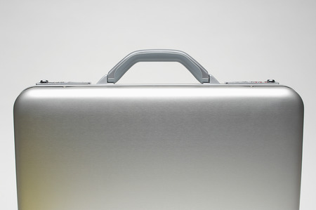 cropped shots: Silver briefcase LANG_EVOIMAGES