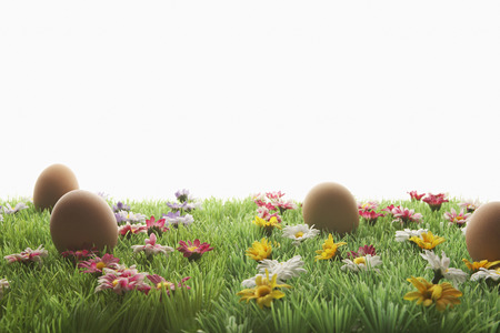 artificial flowers: Easter eggs on artificial meadow