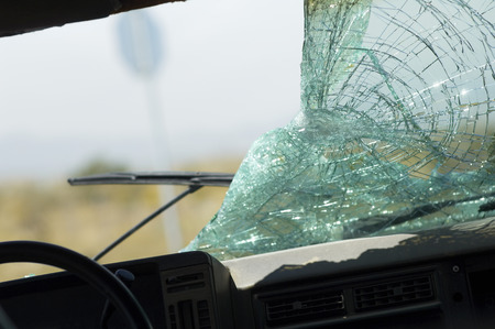 windscreen wiper: Broken car windshield, view from interior LANG_EVOIMAGES