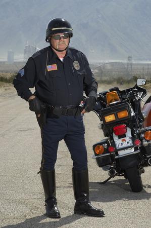 traffic cop: Portrait of traffic cop on road LANG_EVOIMAGES