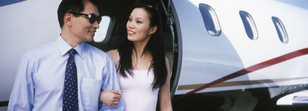 exiting: Couple exiting private plane
