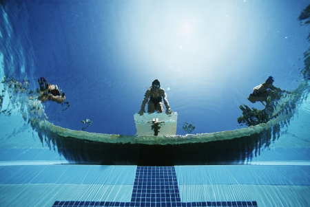 Underwater view of swimmers on diving boards Stock Photo - 3906409