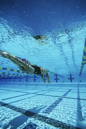 backstroke: Female swimmer in pool, underwater view LANG_EVOIMAGES
