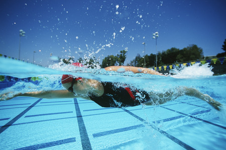Female swimmer in pool, surface view Stock Photo