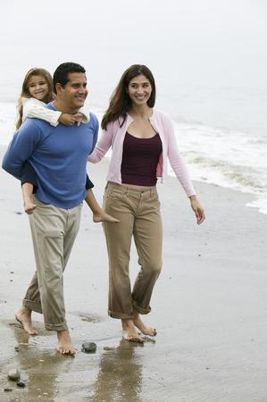 Family walking on beach Stock Photo - 4926020