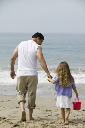 Father and daughter walking on beach Stock Photo - 4926034