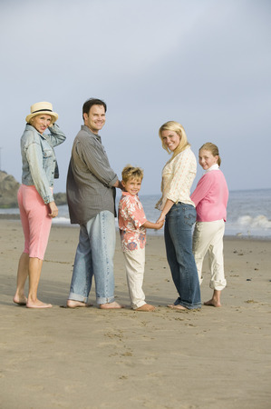 Family standing on beach, portrait Stock Photo - 4926038