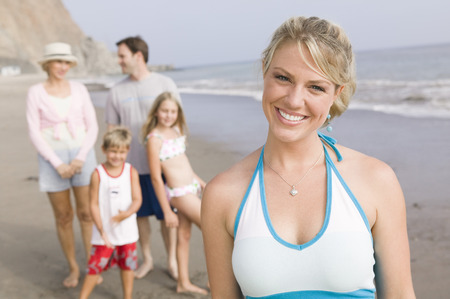 Portrait of woman on beach with family Stock Photo - 4926016