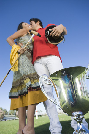 Couple kissing by polo trophy Stock Photo - 4926076