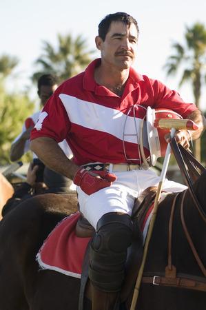 Polo player horseback riding Stock Photo - 4926045