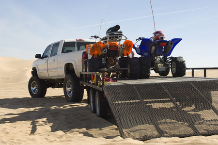 offroad: ATVs on Trailer Behind Pickup Truck