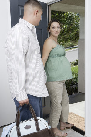 exiting: Expectant couple exiting house