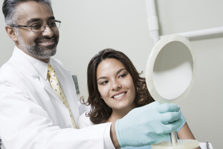 Dentist and patient using mirror Stock Photo - 4925975