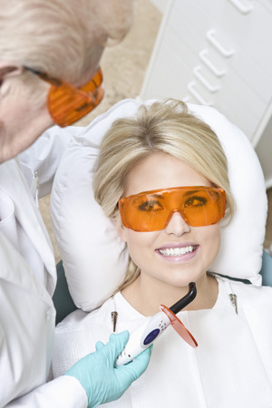 Dentist inspecting patient's teeth Stock Photo - 4925979