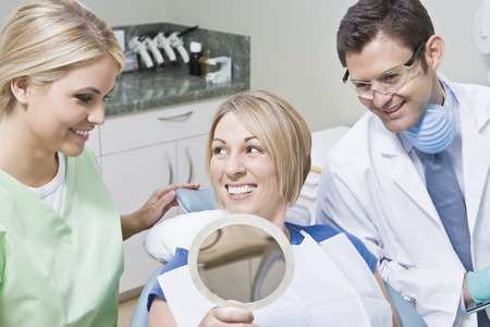 Dentist and patient using mirror Stock Photo - 4926036