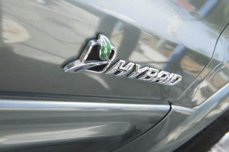 clean  electric: Close up of sing on hybrid car