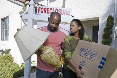 Bankrupt couple moving out of house Stock Photo - 4926053