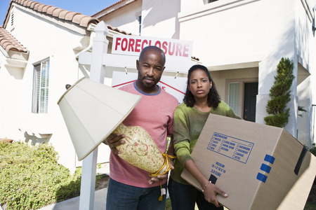 Bankrupt couple moving out of house Stock Photo - 4926081