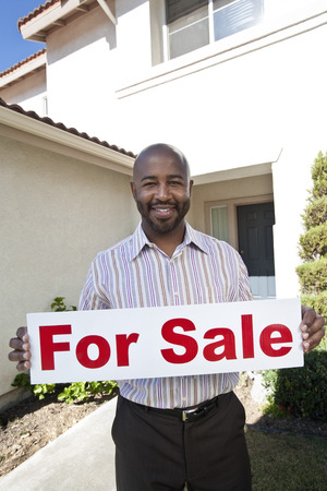 Man holding 'for sale' notice Stock Photo - 4926021