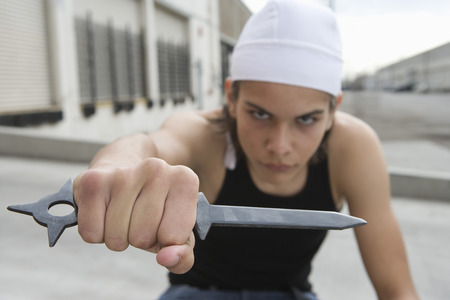 Young man posing with knife Stock Photo - 4926137