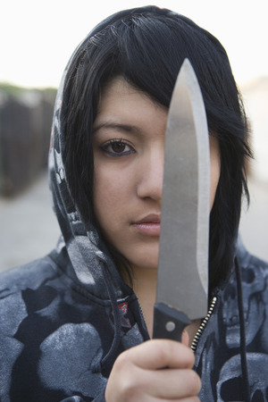 Young woman posing with knife Stock Photo - 4926147