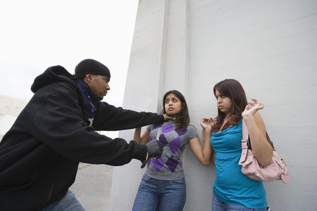 Man robbing young woman with knife Stock Photo - 4926143