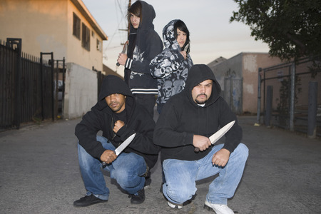 Group of young people posing with knives Stock Photo - 4926149