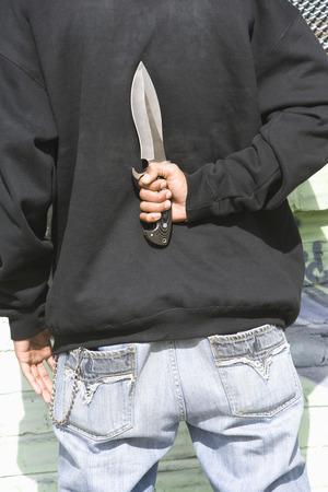 Man holding knife behind back Stock Photo - 4926162