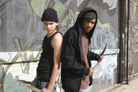 Two young men posing with knives Stock Photo - 4926161