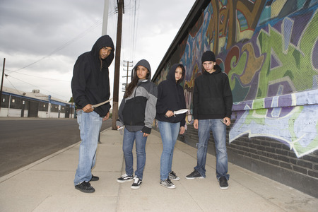 Group of young people posing with knives Stock Photo - 4926159